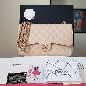Chanel beige caviar jumbo gold hardware bag